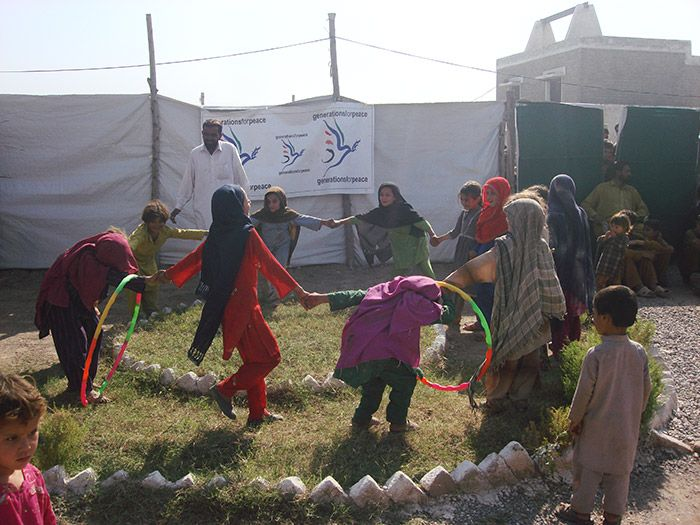 Pakistan, young girls playing with hoola hoops