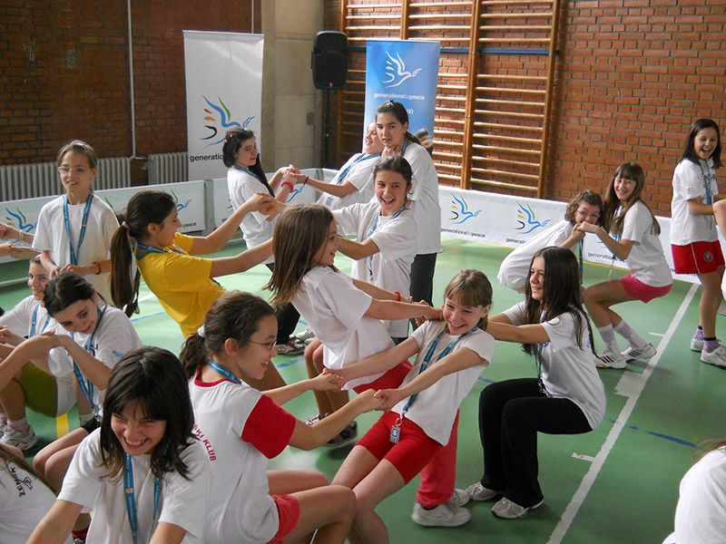 Serbia, girls from the GFP camp playing a game in a gymnasium