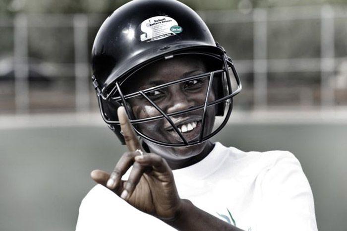 Smiling volunteer wearing a football helmet