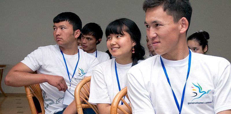Kyrgyzstani volunteers listening carefully