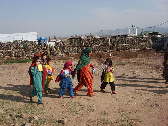 Young Pakistani girls walking outdoors
