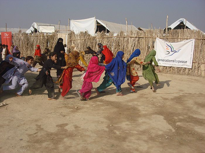 Pakistan, young girls playing a game running around in single file
