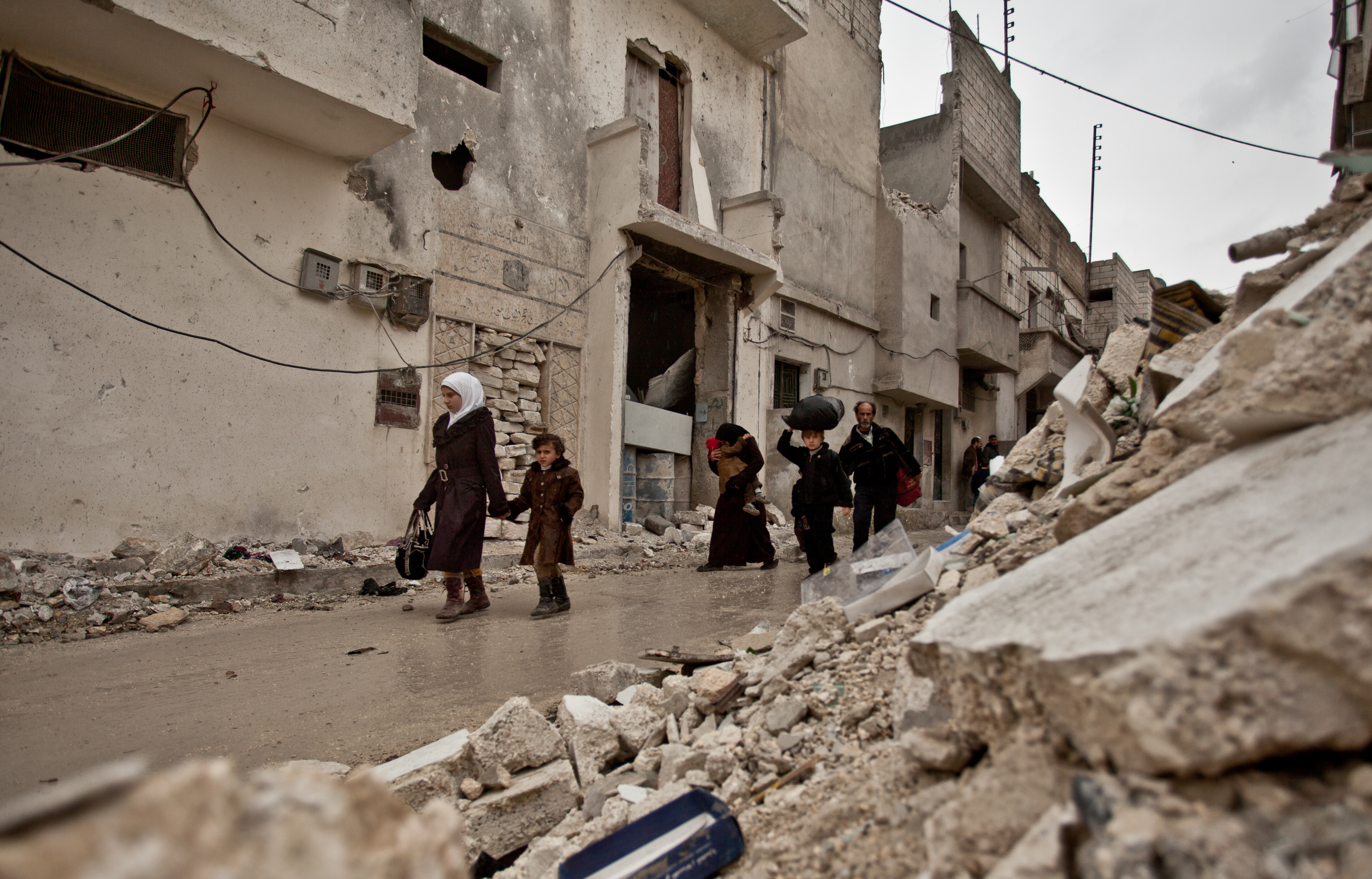 The remains of a neighbourhood that was hit by a missile in Syria. Image: Pablo Tosco