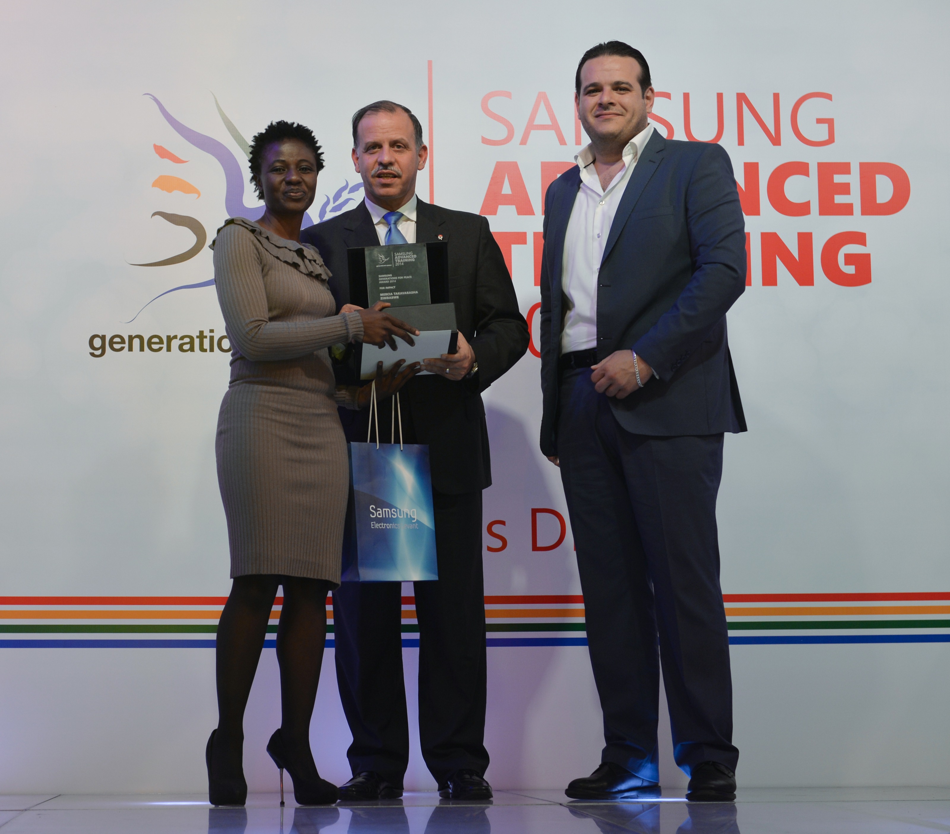 Mercia receiving her award from HRH Prince Feisal Al Hussein and Mr Fadi Awni Abu Shamat (Samsung Levant), and their fellow facilitators